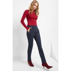 Spodnie w kant. Niebieskie rurki damskie marki Orsay, z haftami, z bawełny. Za 119,99 zł.