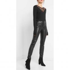 Spodnie z wysokim stanem. Czarne rurki damskie marki Orsay, z poliesteru, z podwyższonym stanem. Za 99,99 zł.