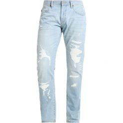Armani Exchange Jeansy Slim Fit denim indigo. Czarne jeansy męskie relaxed fit marki Armani Exchange, l, z materiału, z kapturem. W wyprzedaży za 517,65 zł.