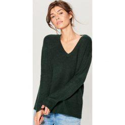 Sweter oversize - Khaki. Czerwone swetry oversize damskie marki Mohito, z bawełny. Za 99,99 zł.
