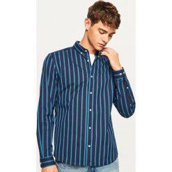 Koszula regular fit w paski - Niebieski. Niebieskie koszule męskie na spinki Reserved, l, w paski. W wyprzedaży za 49,99 zł.