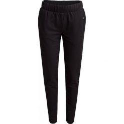 Spodnie dresowe damskie  SPDD601 - czarny - Outhorn. Czarne spodnie dresowe damskie Outhorn, na lato, z bawełny. W wyprzedaży za 49,99 zł.