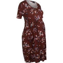Sukienka ciążowa shirtowa bonprix czerwony kasztanowy w kwiaty. Niebieskie sukienki ciążowe marki DOMYOS, z elastanu, street, z okrągłym kołnierzem. Za 59,99 zł.