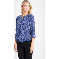 Bluzki asymetryczne: Niebieska bluzka bombka QUIOSQUE
