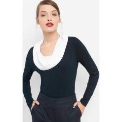 Koszulka z luźnym golfem. Niebieskie bluzki nietoperze marki Orsay, z dzianiny, z golfem. Za 99,99 zł.