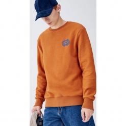 Polarowa bluza z etnicznym haftem. Pomarańczowe bluzy męskie rozpinane marki Pull&Bear, m, z haftami, z polaru. Za 99,90 zł.