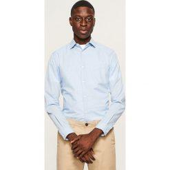 Koszula slim fit - Niebieski. Niebieskie koszule męskie slim marki QUECHUA, m, z elastanu. Za 69,99 zł.