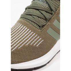 Adidas Originals SWIFT RUN Tenisówki i Trampki base green/core black. Szare tenisówki damskie marki adidas Originals, z gumy. W wyprzedaży za 359,10 zł.
