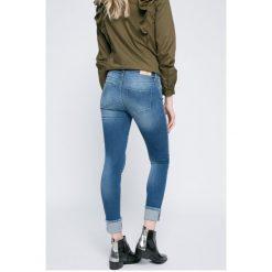 Only - Jeansy Carmen. Szare jeansy damskie rurki marki ONLY, s, z bawełny, casualowe, z okrągłym kołnierzem. W wyprzedaży za 89,90 zł.