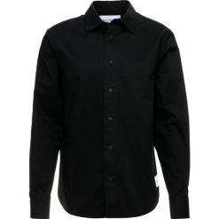 Calvin Klein Jeans INSTITUTIONAL LOGO Koszula black. Czarne koszule męskie jeansowe marki Calvin Klein Jeans, m. Za 419,00 zł.