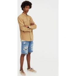 Koszula jeansowa w kowbojskim stylu. Szare koszule męskie jeansowe marki Pull&Bear, m, z długim rękawem. Za 62,90 zł.