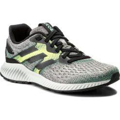 Buty adidas - Aerobounce M CG4658 Cblack/Sslime/Hiregr. Czarne buty do biegania męskie marki Adidas, z kauczuku. W wyprzedaży za 299,00 zł.