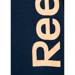 Reebok - Top dziecięcy 104-164 cm. Czarne bluzki dziewczęce bawełniane Reebok, z nadrukiem, z okrągłym kołnierzem, z krótkim rękawem. W wyprzedaży za 39,90 zł.