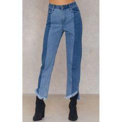 Spodnie damskie: Qontrast X NA-KD Jeansy z asymetrycznym brzegiem - Blue