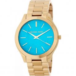 """Zegarek kwarcowy """"Slim Runway"""" w kolorze turkusowo-złotym. Żółte, analogowe zegarki damskie Michael Kors, ze stali. W wyprzedaży za 454,95 zł."""