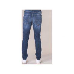 Jeansy slim fit Diesel  TEPPHAR. Niebieskie jeansy męskie relaxed fit marki Diesel. Za 527,20 zł.