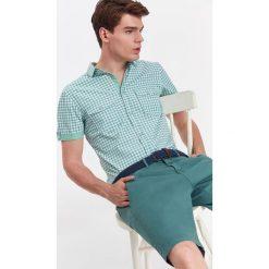 KOSZULA MĘSKA W KRATĘ Z LEKKIEJ TKANINY O KROJU SLIM. Brązowe koszule męskie slim marki QUECHUA, m, z elastanu, z krótkim rękawem. Za 29,99 zł.