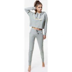 Cardio Bunny - Spodnie Pretty. Brązowe spodnie sportowe damskie marki DOMYOS, xs, z bawełny. Za 199,90 zł.