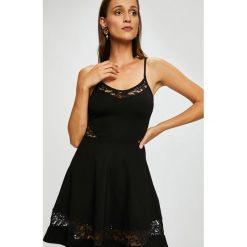Tally Weijl - Sukienka. Szare sukienki dzianinowe marki TALLY WEIJL, na co dzień, l, casualowe, mini, rozkloszowane. W wyprzedaży za 99,90 zł.