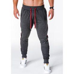 SPODNIE MĘSKIE DRESOWE P715 - GRAFITOWE. Szare spodnie dresowe męskie marki Ombre Clothing, z bawełny. Za 49,00 zł.