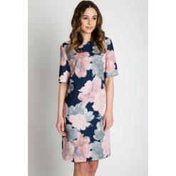 Sukienki balowe: Rozszerzana sukienka z krótkim rękawem BIALCON