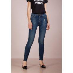 Emporio Armani Jeans Skinny Fit blue denim. Niebieskie jeansy damskie relaxed fit Emporio Armani, z bawełny. Za 689,00 zł.