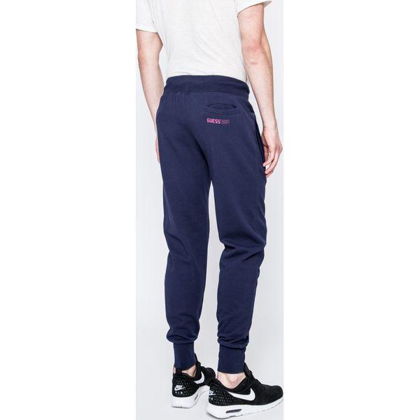 0d44124eff486 Guess Jeans - Spodnie - Szare jeansy męskie z dziurami marki Guess ...