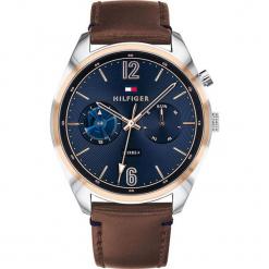 """Zegarek kwarcowy """"Deacan"""" w kolorze brązowo-srebrno-niebieskim. Brązowe, analogowe zegarki męskie TOMMY HILFIGER, ze stali. W wyprzedaży za 500,95 zł."""