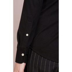 Polo Ralph Lauren HEIDI Koszula black. Czarne koszulki polo damskie marki Polo Ralph Lauren, xs, z bawełny, polo. Za 509,00 zł.