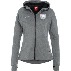Nike Performance ENT ENGLAND  Koszulka reprezentacji carbon heather/white. Brązowe bluzki sportowe damskie marki N/A, w kolorowe wzory. W wyprzedaży za 407,20 zł.