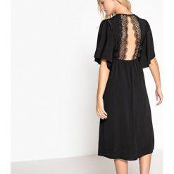 Sukienki hiszpanki: Gładka, rozkloszowana, półdługa sukienka
