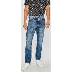 Wrangler - Jeansy Slider Bang On. Niebieskie jeansy męskie slim marki Wrangler. Za 349,90 zł.