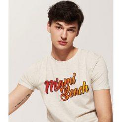 T-shirt z napisem - Kremowy. Białe t-shirty męskie House, l, z napisami. Za 25,99 zł.