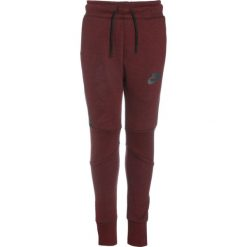 Nike Performance TECH PANT Spodnie treningowe dark team red/heather/anthracite. Czerwone spodnie chłopięce marki Nike Performance, z bawełny. W wyprzedaży za 164,45 zł.