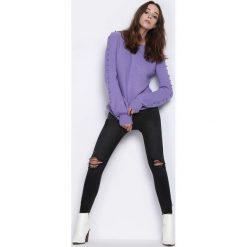Fioletowy Sweter Flying Uptight. Fioletowe swetry klasyczne damskie marki DOMYOS, l, z bawełny. Za 74,99 zł.