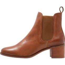 KIOMI Ankle boot cognac. Brązowe botki damskie na zamek KIOMI, z materiału. Za 379,00 zł.