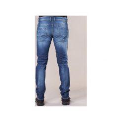 Jeansy slim fit Diesel  THOMMER. Niebieskie jeansy męskie relaxed fit marki Diesel. Za 631,20 zł.