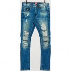 Jeansy SLIM - Niebieski. Niebieskie jeansy męskie slim marki Cropp. Za 139,99 zł.