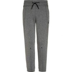 Nike Performance Spodnie treningowe carbon heather/black/heather. Brązowe spodnie chłopięce marki N/A, w kolorowe wzory. W wyprzedaży za 168,35 zł.