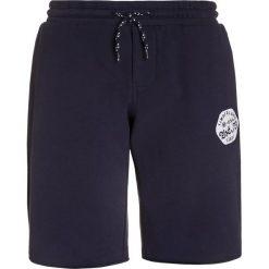 Timberland Spodnie treningowe blue indigo. Niebieskie spodnie chłopięce Timberland, z bawełny. Za 159,00 zł.