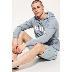 Bluza z napisem - Niebieski. Czarne bluzy męskie rozpinane marki Reserved, l, z napisami. Za 89,99 zł.