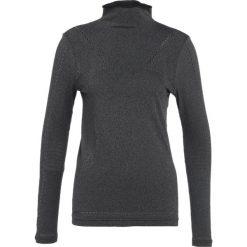 Puma EVOKNIT Koszulka sportowa black. Czarne topy sportowe damskie marki Puma, xl, z materiału, z długim rękawem. W wyprzedaży za 135,20 zł.