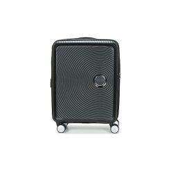 Walizki twarde American Tourister  SOUNDBOX 55CM 4R. Czarne walizki marki Dakine, z materiału. Za 549,00 zł.