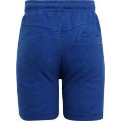 Tumble 'n dry LUCO Spodnie treningowe college blue. Niebieskie jeansy chłopięce Tumble 'n dry. Za 129,00 zł.