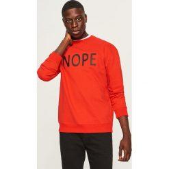 Bluza z aplikacją Nope - Czerwony. Czerwone bluzy męskie rozpinane Reserved, l, z aplikacjami. Za 99,99 zł.