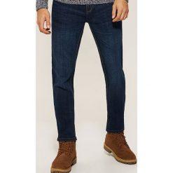 Jeansy regular fit - Granatowy. Niebieskie jeansy męskie regular House. Za 129,99 zł.