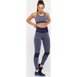 Spodnie damskie: Asics Legginsy damskie Seamless Tight niebieskie r. S (146408-8052)