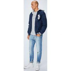 Tommy Jeans - Jeansy Modern Tapered. Niebieskie jeansy męskie z dziurami marki Tommy Jeans. W wyprzedaży za 399,90 zł.