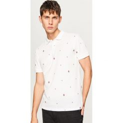 Koszulka polo w drobny wzór - Biały. Białe koszulki polo Reserved, l. W wyprzedaży za 29,99 zł.