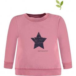 Bluza w kolorze jasnoróżowym. Czerwone bluzy dziewczęce rozpinane marki bellybutton, z nadrukiem, z bawełny. W wyprzedaży za 37,95 zł.